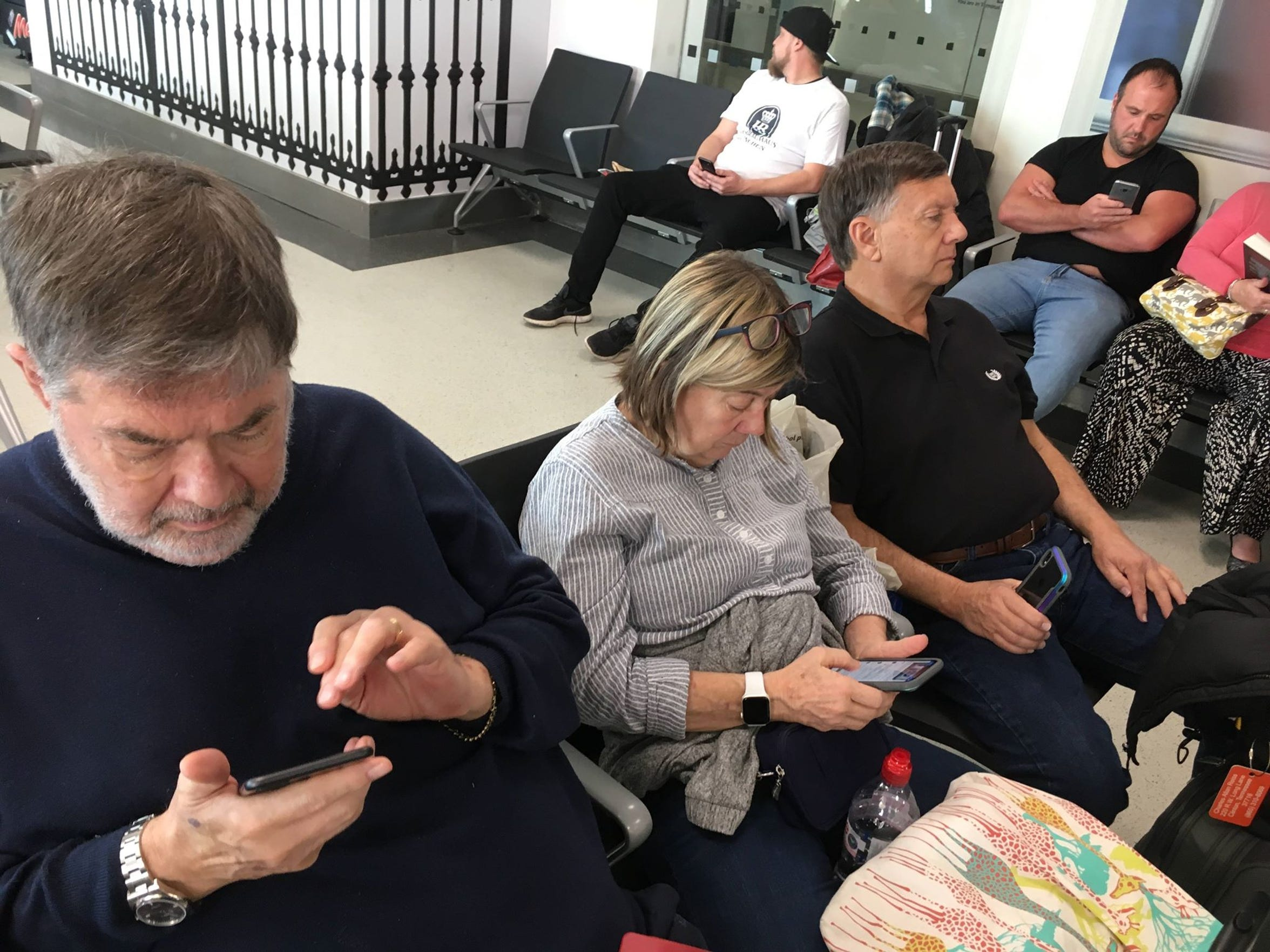 From left, Allan Reiss, Laura Wolfe and Richard Wolfe wait for a flight back to the United States from London's Heathrow Airport. The three were on board the Viking Sky cruise ship with Jamey Kennedy when engine failure stranded them in the middle of a storm.