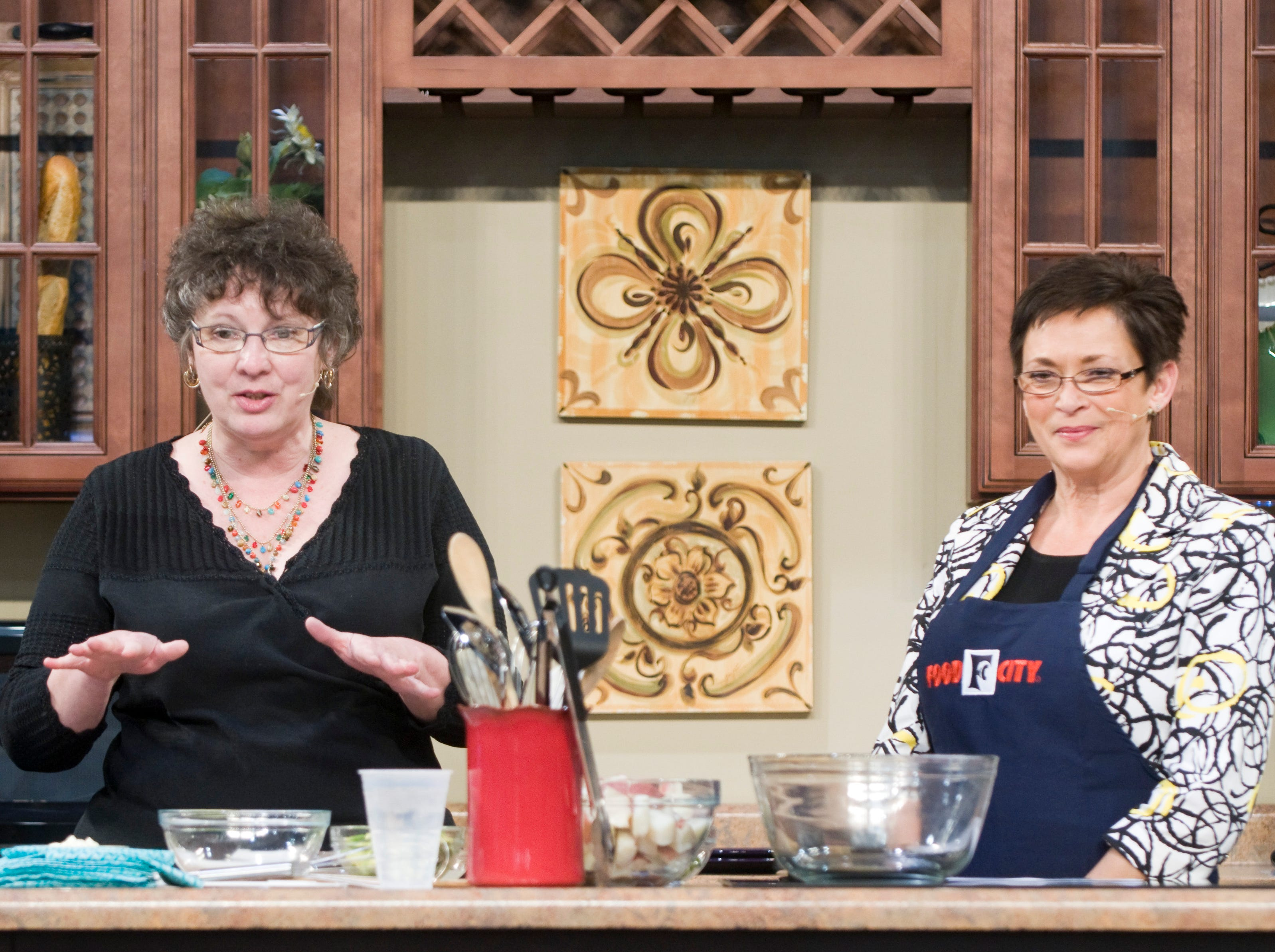 News Sentinel food editor Mary Constantine, left, and Janis Katz, (cq) the winner of the Easter Dinner Cooking Contest with a recipe for Bacon Avocado Potato Salad on the Food City Cooking School Stage.