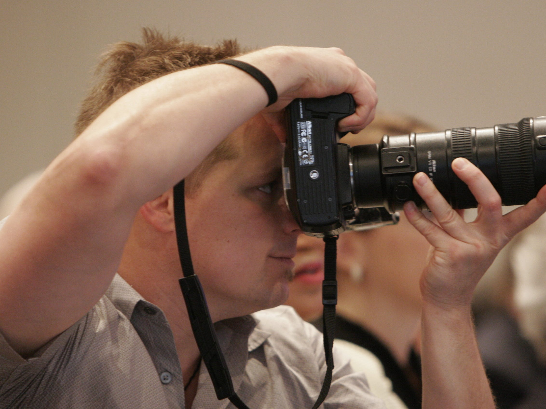 News Sentinel photographer Joe Howell photographs a swearing-in ceremony for new Tennessee Valley Authority Board members Friday, March 31, 2006, at the Knoxville Convention Center.