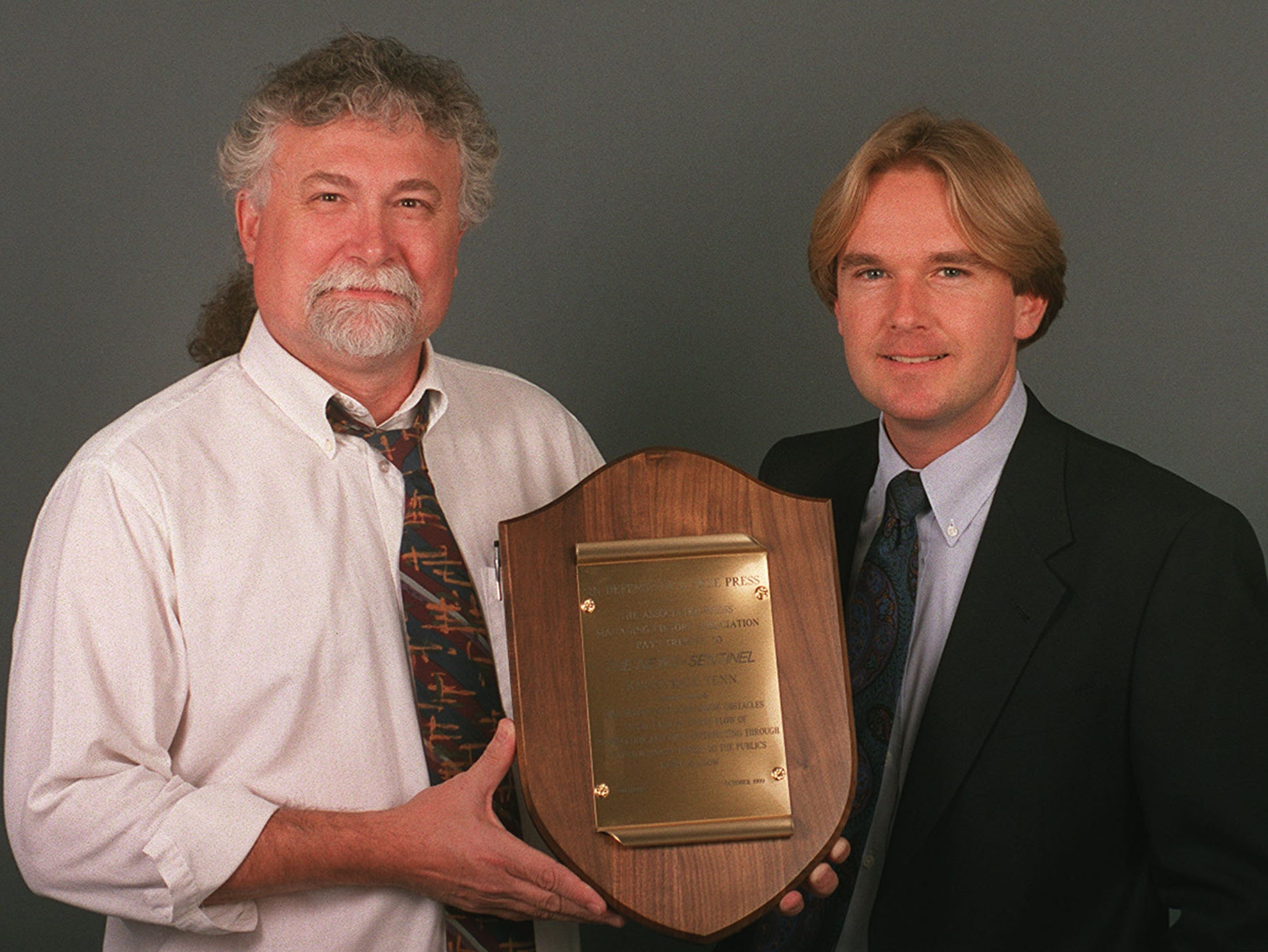 Knoxville News-Sentinel Assistant Managing Editor Tom Chester, left, and reporter John North are pictured with the Associated Press Managing Editors Association's Freedom of Information Award on Oct. 22, 1999. The APME selected the News-Sentinel from among 10 finalists nationwide for the annual award, citing the paper for publishing information obtained from court records about serial killer Thomas D. Huskey's court-appointed defense.