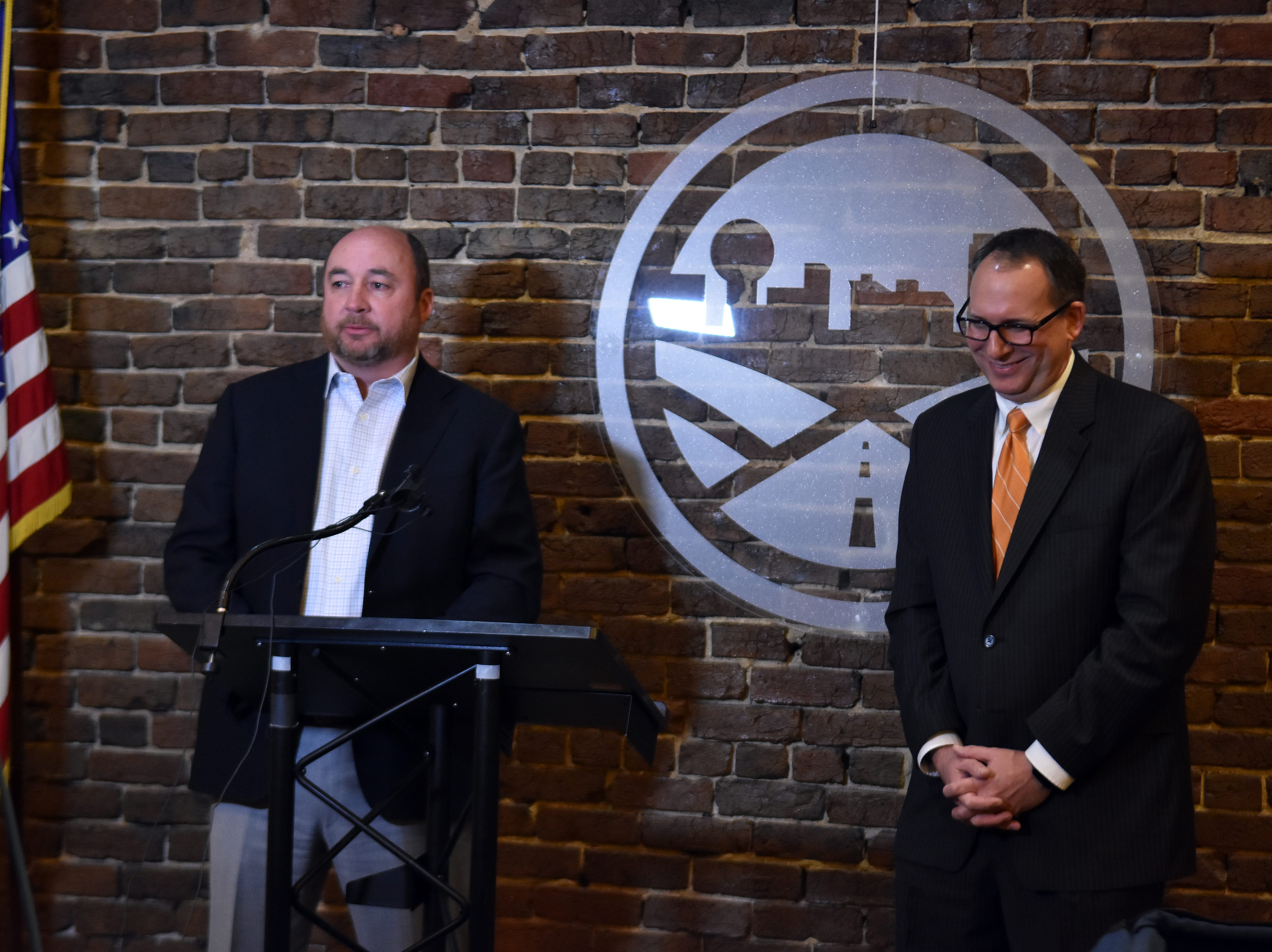 Terry Turner, chair of the Knoxville Chamber Board of Directors, left, answers questions with Mike Odom, the new Chamber CEO during a press conference on Tuesday, March 16.