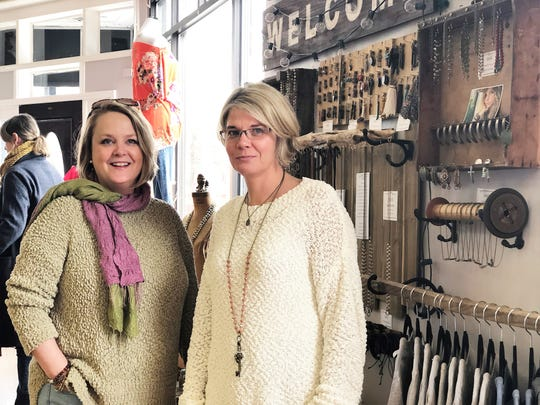 "Folly Boutique owner, Becky Walker and SNIG creator, Diane Carter at Folly Boutique's 5th birthday celebration in Fountain City, March 9. Through failures and successes, the two have remained each other's sounding boards for their own aspirations. ""We have failed together and succeeded together, but we have had a ton of fun together, we are like sisters,"" said Carter."