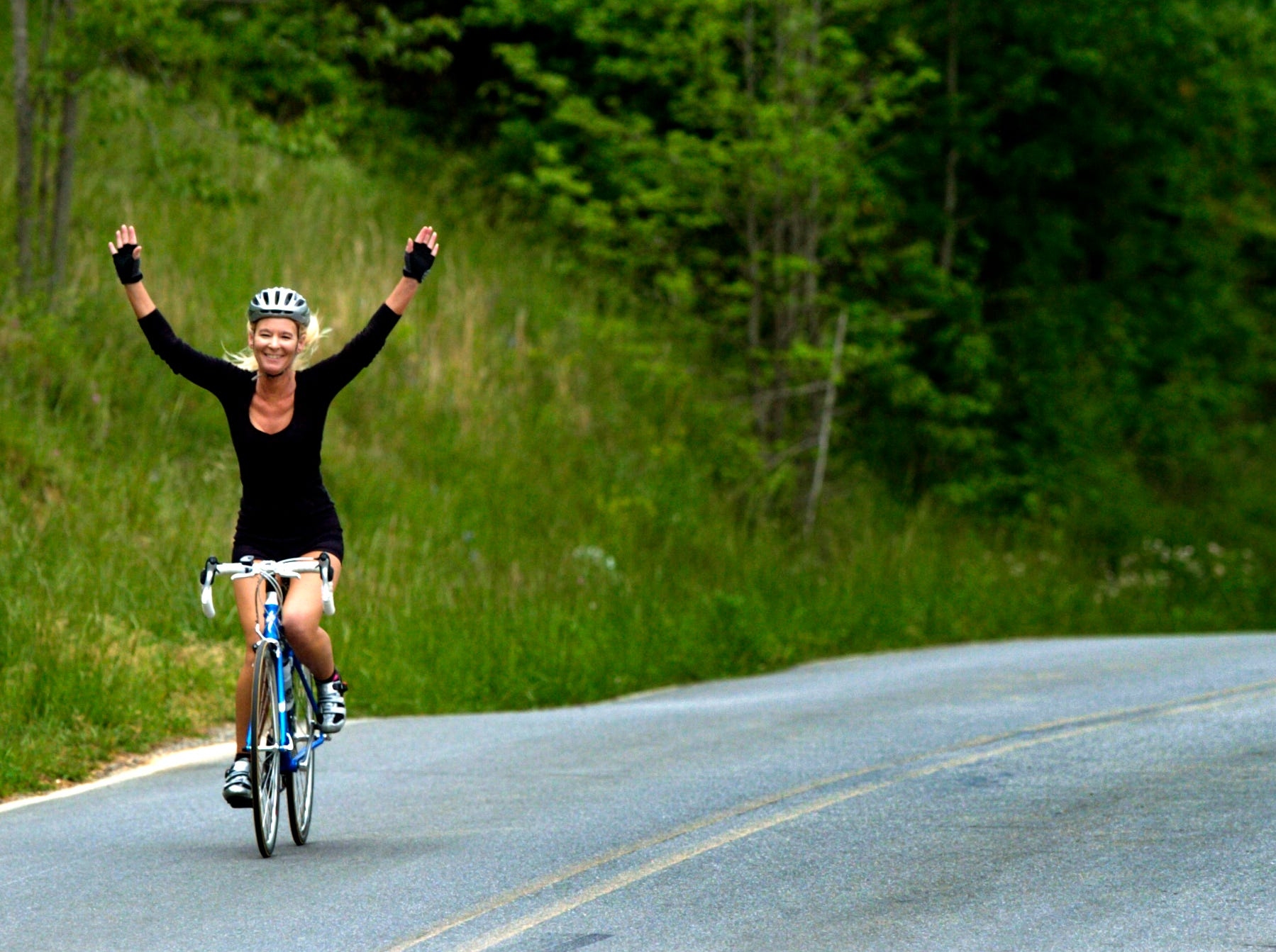 Reporter and novice cyclist Jamie Satterfield strikes a Lance Armstrong like pose while riding back down the hill from practicing for an upcoming Southern Cycling Operations' annual English Mountain Challenge Ride on May 8, 2008.