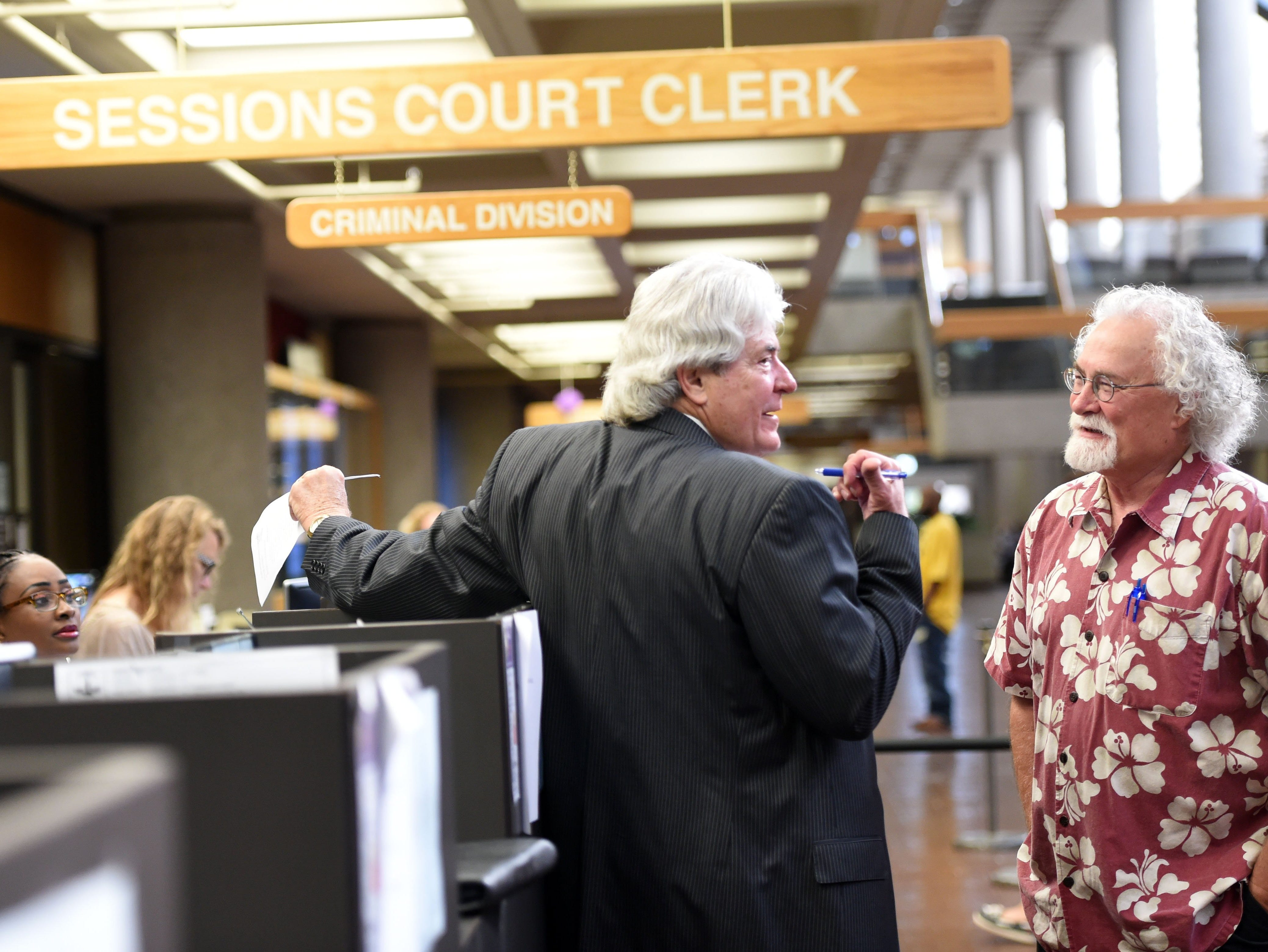 Attorney James A.H. Bell, left, talks with KNS managing editor Tom Chester after DUI charges were dismissed against Hollis Walker in Knox County General Sessions Court Monday August 22, 2016.