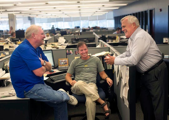 News Sentinel columnist Sam Venable, right, visits with former KNS outdoor writer Bob Hodge, left, and KNS reporter Morgan Simmons on Sept. 5, 2014, before Venable's retirement party.