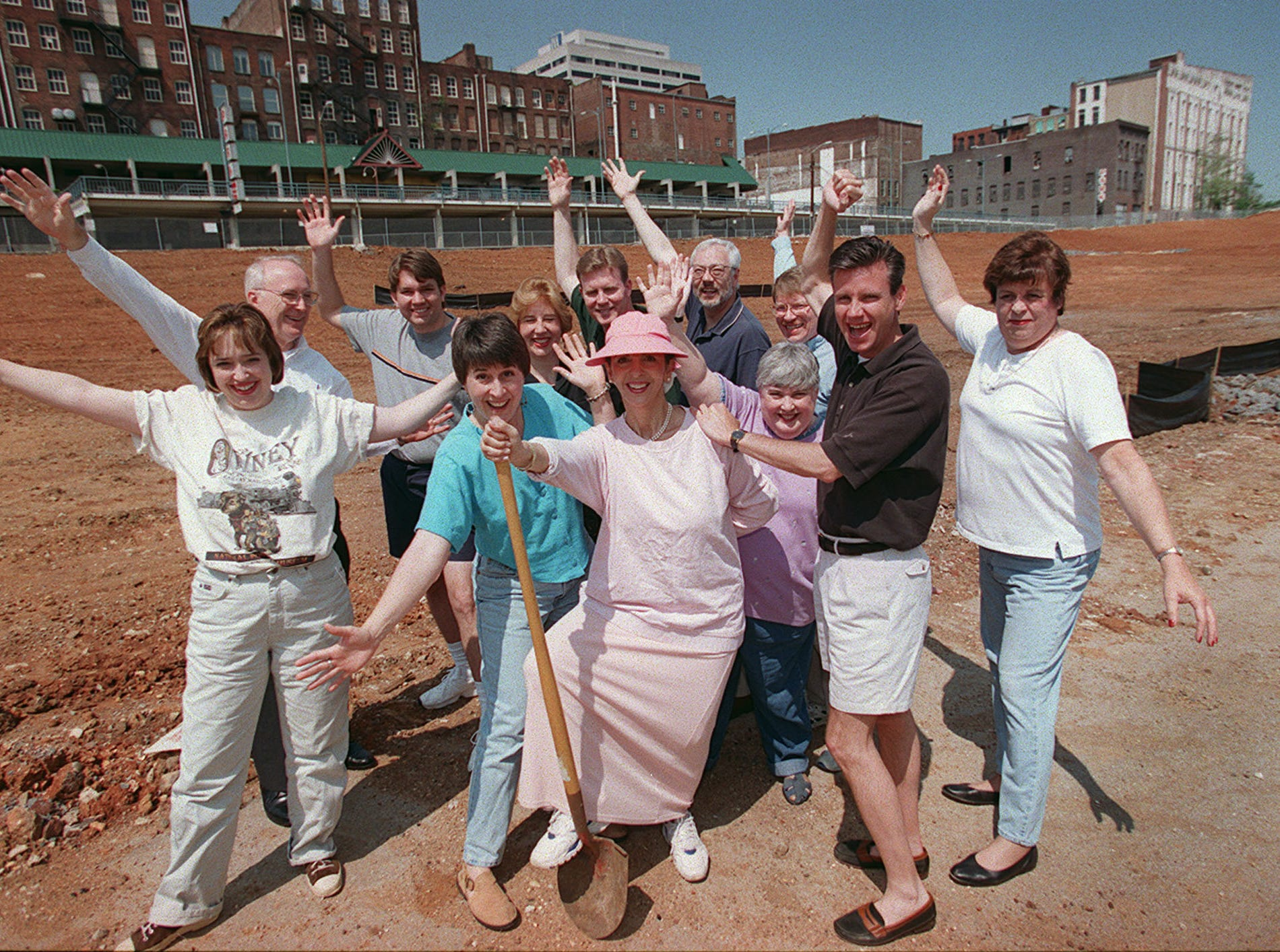 In a May 6, 2000, photograph, Front Page Follies cast members attempt to fill the void left by the ill-fated downtown justice center. Pictured are: ( front row, from left) Kristi Nelson, Carol Zinavage, Anne McKinney, Suzanne Foree Neal, Gary Loe and Barbara Womack; (back row, from left) Ed Miller, Monty Howard, Lisa Hood Skinner, Steve Skinner, Alan Carmichael and David Lauver. The Follies, presented by the East Tennessee Chapter of the Society of Professional Journalists, will be held Saturday, May 20, at the Radisson Hotel.