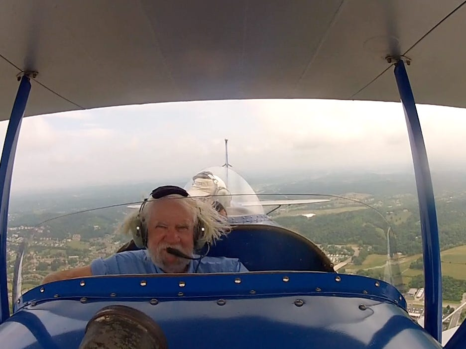 A video screengrab of J. Miles Cary in a byplane while on assignment at a Sevierville business in July 2014.