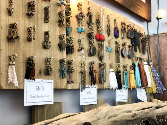 """I rolled the interchangeable concept from bracelets over to necklaces and then that took off,"" said Diane Carter, SNIG owner. ""It allows me to create the look for them, but give them options to personalize it."" Choice of pendants to customize jewelry at Folly Boutique."