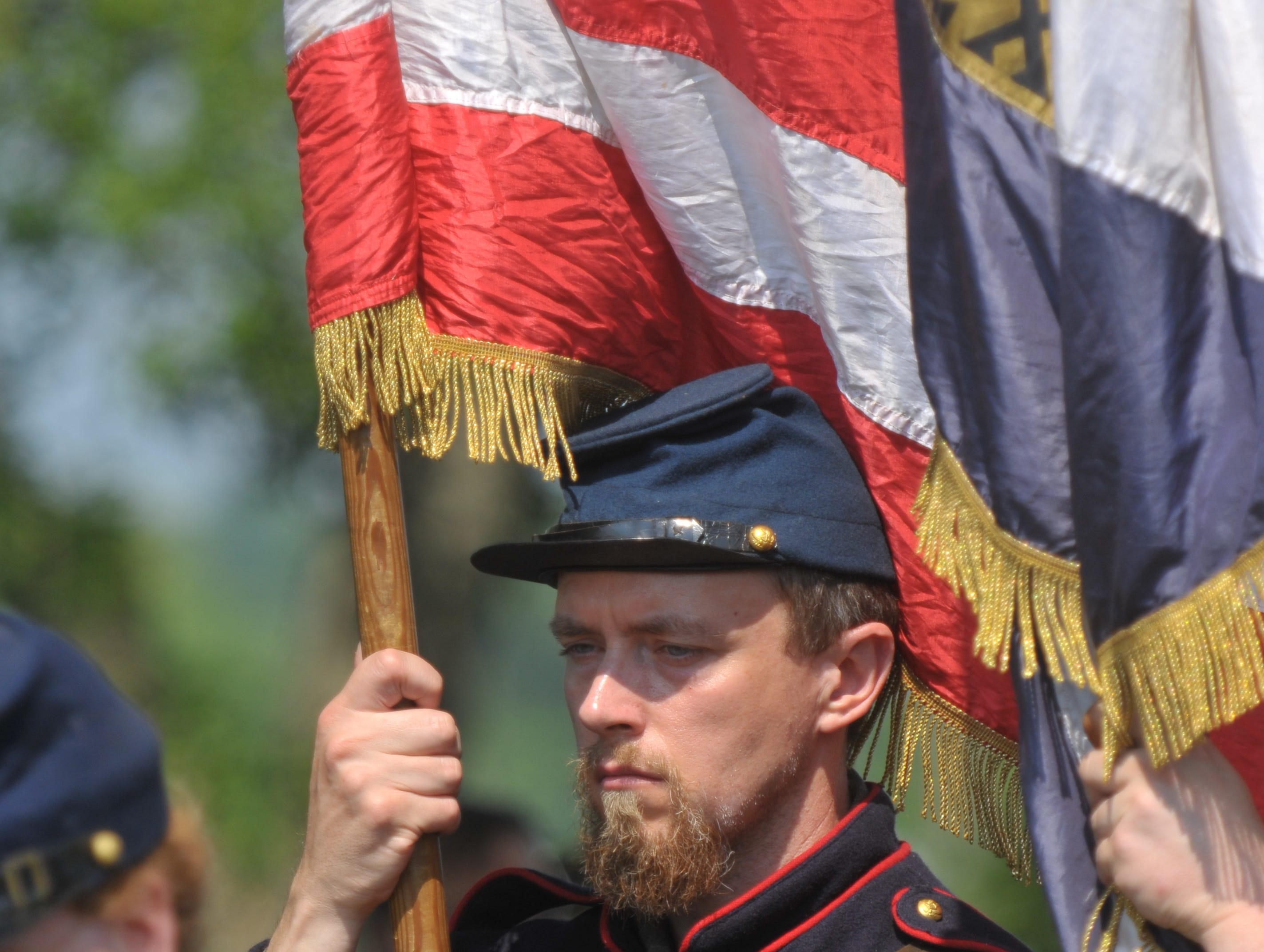 KNS reporter Matt Lakin was one of the re-enactors from the 79th New York Infantry, Company A, East Tennessee, taking part in a Memorial Day observance Monday, May 30, 2011 at the Knoxville National Cemetery. The Lucinda Heatherly Chapter of the Daughters of Union Veterans of the Civil War hosted the ceremony.