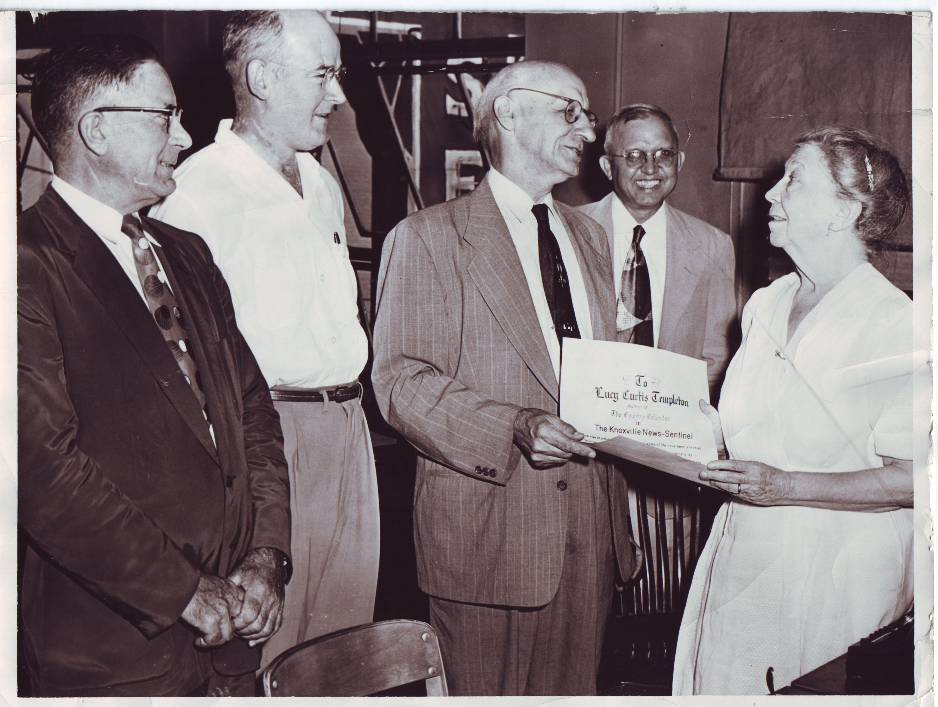 """In an Aug. 16, 1955 photograph, Knoxville News Sentinel writer Lucy Curtis Templeton is honored for her column, """"A Country Calendar,"""" by the Men's Garden Club. Pictured are Past President Dan. E. Baird, left, Secretary-Treasurer John B. Walker, President Karl E. Steinmetz, Past President W.C. McCammon Jr. and Templeton.  In making the presentation Steinmetz compared the material in Templeton's """"A Country Calendar"""" to Thoreau's Walden."""