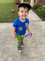 "New ""officer"" Brigsby Langford, 2, got a closer look at a police car thanks to two patrolling Broussard Police officers Monday. They also gave him a stuffed animal and a sticker badge."