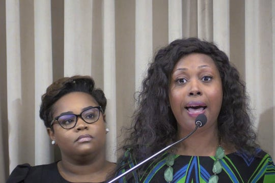 Council member Keisha Dorsey, left, listens as council member Jessica Green speaks during a press conference Tuesday regarding council's recent defeat of a tax hike.