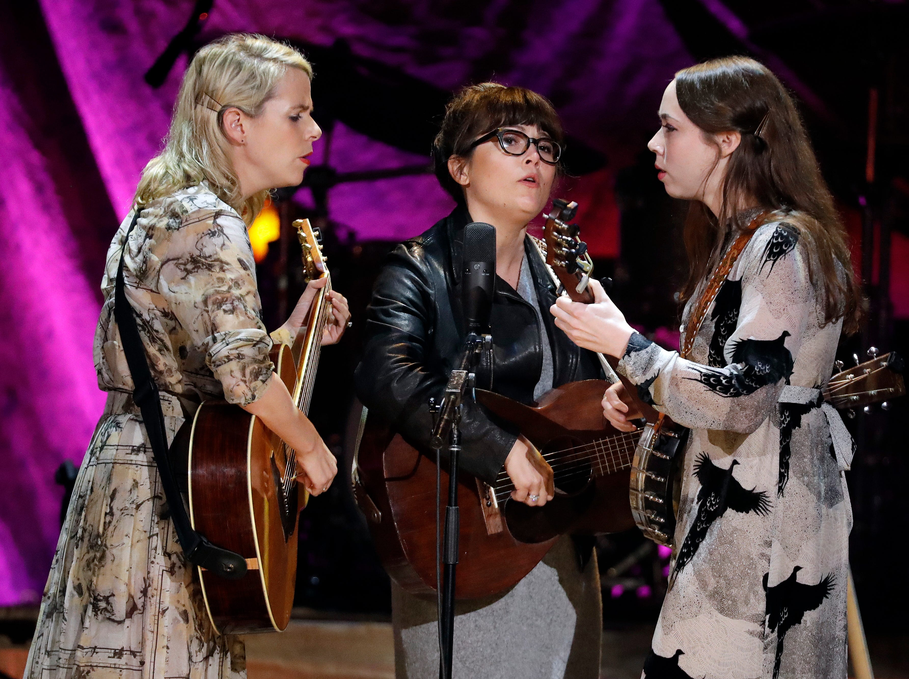 The trio I'm With Her performs at the Americana Honors and Awards show Wednesday, Sept. 12, 2018, in Nashville, Tenn. From left are Aoife O'Donovan, Sara Watkins and Sarah Jarosz. (AP Photo/Mark Zaleski)