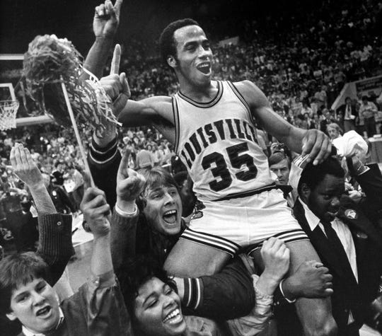 Louisville's Darrell Griffith flashes number one sign as he's hoisted on shoulders of teammates and fans after winning NCAA basketball championship Monday, March 24, 1980 at Indianapolis.  Louisville Cardinals won their first national championship ever, defeating UCLA, 59-54.