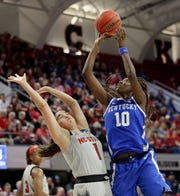 North Carolina State's Aislinn Konig (1) defends against Kentucky's Rhyne Howard (10) during the first half of a second round women's college basketball game in the NCAA Tournament in Raleigh, N.C., Monday, March 25, 2019.