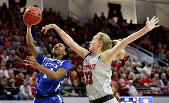 Kentucky's Tatyana Wyatt drives to the basket while North Carolina State's Elissa Cunane (33) defends during the first half of a second round women's college basketball game in the NCAA Tournament in Raleigh, N.C., Monday, March 25, 2019.