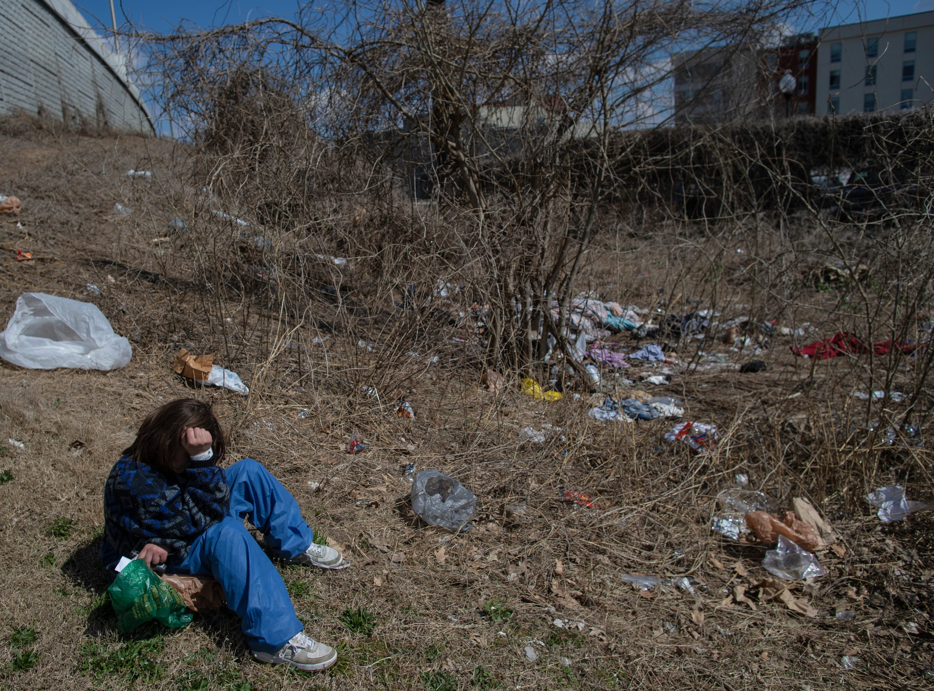 """Felecia, who declined to give her last name, takes a break from trying to relocate some of her belongings at the homeless camp area under the bypasses along East Jefferson Street and Jackson Street in downtown Louisville. """"I've been homeless two years and it's the meth,"""" Felecia said. """"At this point, I'm just allowing it to hold me under water."""" March 18, 2019"""