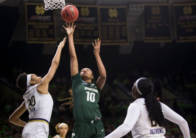 Michigan State's Sidney Cooks (10) goes up to shoot over Notre Dame's Mikayla Vaughn (30) and Arike Ogunbowale during a second-round game in the NCAA women's college basketball tournament in South Bend, Ind., Monday, March 25, 2019. (AP Photo/Robert Franklin)
