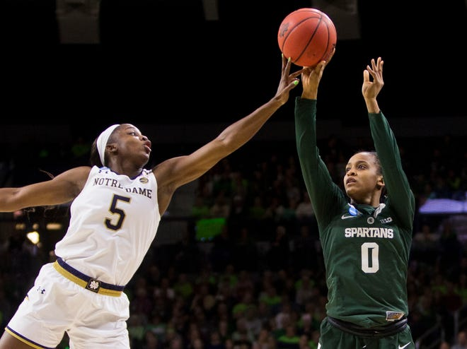Notre Dame's Jackie Young (5) blocks a shot by Michigan State's Shay Colley (0) during a second-round game in the NCAA women's college basketball tournament in South Bend, Ind., Monday, March 25, 2019. (AP Photo/Robert Franklin)