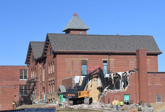 An old, secondary gymnasium was the first part of the historic Bellville School to be torn down as demolition got under way Tuesday.