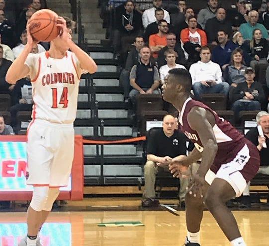 Willard senior Davon Triplett strikes a defensive stance in this year's Division II regional semifinal clash with Coldwater.