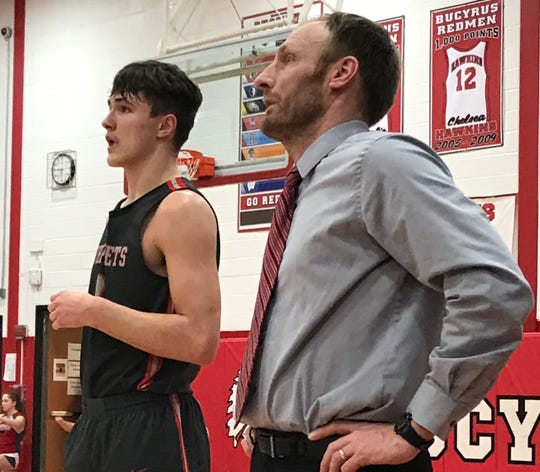 Uriah Schwemley and his dad, Troy, Shelby's varsity head basketball coach, made their marks in high school as three-sport standouts.