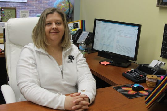 Traci Kinsler sits at her desk as the new health commissioner for Marion Public Health on Monday.