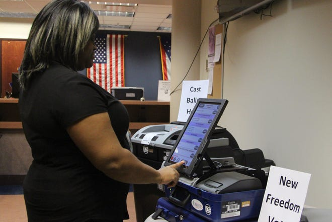 An employee of the Marion County Board of Elections votes on a mock ballot on Monday. The office is showcasing some of its new voting equipment this week that will be used in the upcoming May primary.