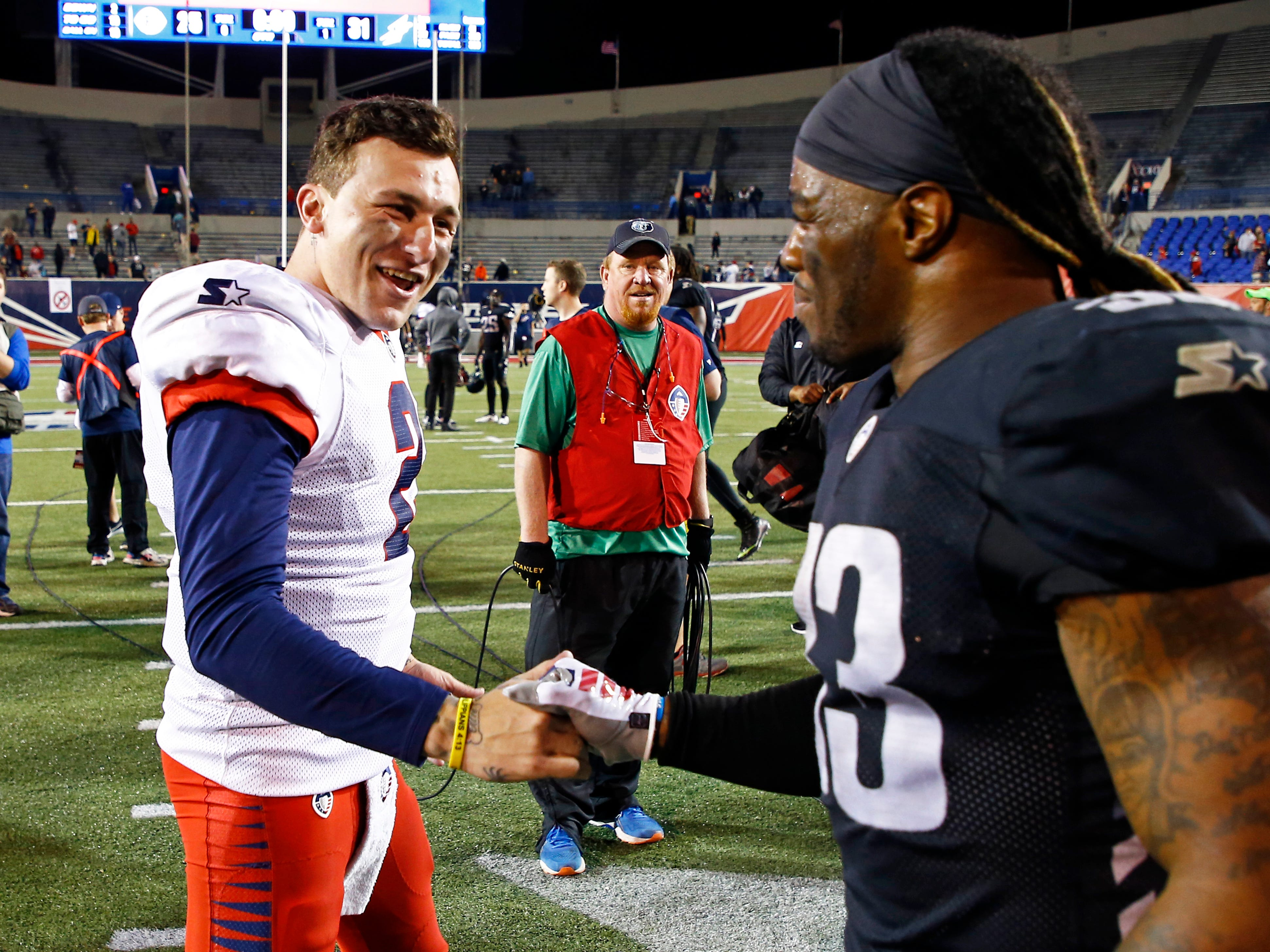 Memphis Express quarterback Johnny Manziel (2) is congratulated by Birmingham Iron running back Trent Richardson (33) after a Birmingham Iron at Memphis Express AAF football game, Sunday, March 24, 2019, at Liberty Bowl Memorial Stadium in Memphis.