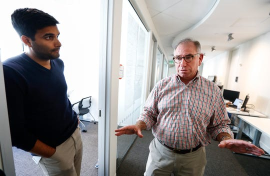 Barry Knight (right) Head of Indigo Research Partners chats with Pranav Tadi (left) Director of Corporate Development in their downtown headquarters. The companies move came with millions in state and local incentives and a promise to create 700 new jobs that pay an average of $90,000.