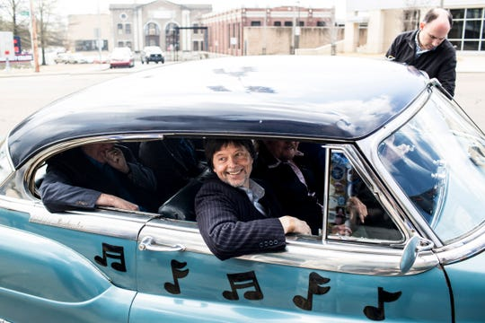 "Famed documentary filmmaker Ken Burns rolls up to Sun Studios in a Cadillac during a visit as part of a bus tour to promote the new 8-part series ""Country Music."""