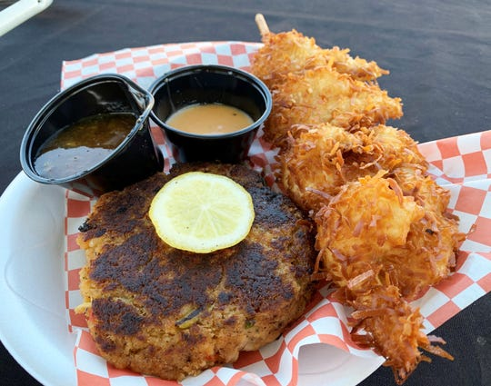 A crab cake and a coconut shrimp skewer from Blackjax.
