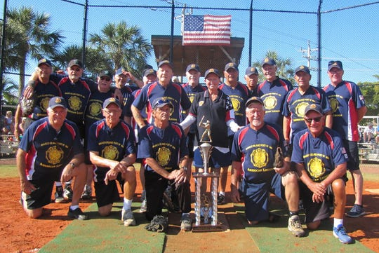 The American Legion Post is the Gulf Coast Division tournament champions. From left, back: Al Bozzo, Denny Lello, Jerry Lenhoff, Steve Slaggie (Alumni), Manager Jim Conway, Dan Callahan, Mike Gallagher, Trish Conway (statistician), Tony Brock, Bill Diamond, Jack Patterson (coach), Charles Pineno and Doug Patton; front: Darryl Judson (coach), Dick DeAnna, Paul Burnett, Leon Schmitt and Tom Patterson.