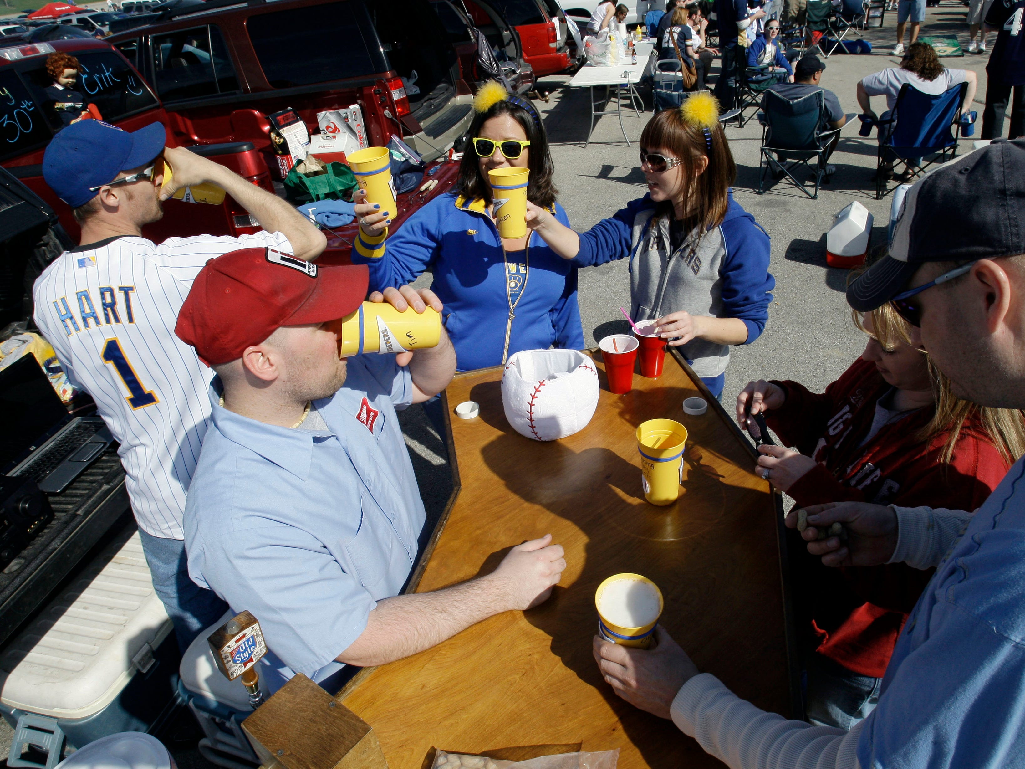 Tim Lucci (foreground left) entertain his friends with a homemade bar he brought for tailgating before the Milwaukee Brewers' home opener against the Colorado Rockies April 5, 2010, at Miller Park. Lucci, who has been coming to opening day fine nine years, was expecting about 30 people for his party. The Brewers lost to the Rockies, 5-3.