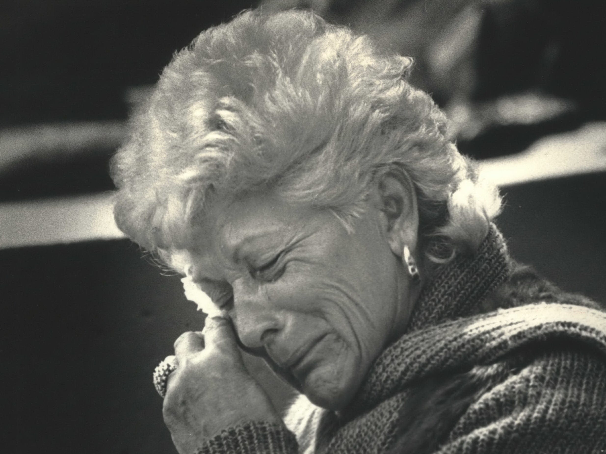 Audrey Kuenn, the widow of former Milwaukee Brewers Manager Harvey Kuenn, wipes away a tear during a tribute to her late husband before opening day on April 15, 1988, at County Stadium. She was later one of four people who threw out the ceremonial first pitch. The Brewers lost the 1988 home opener, 7-1, to the New York Yankees before a sellout crowd of 55,887. This photo was on the front page of the April 16, 1988, Milwaukee Journal.