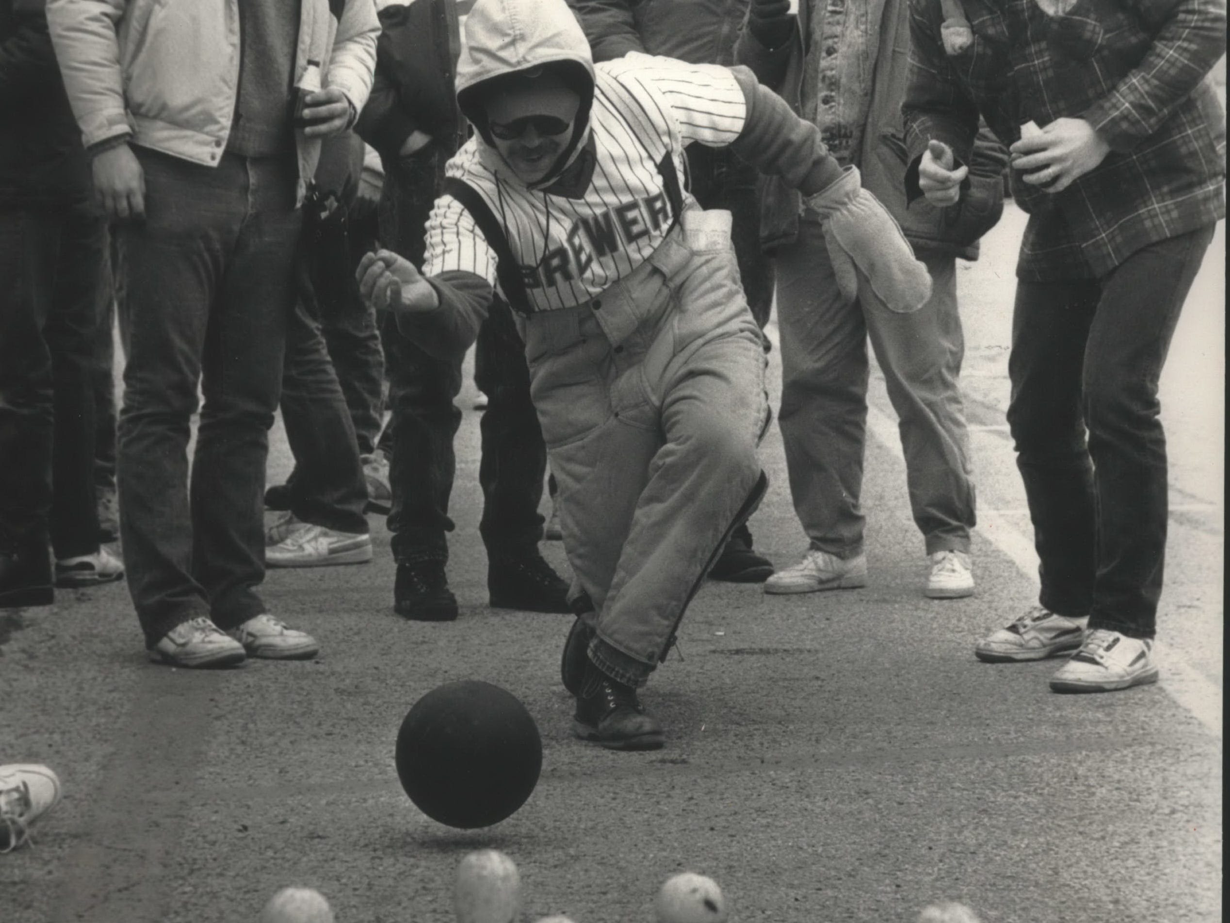 Mark Dolezar, in mittens, aims for the pins during some pregame bowling in the County Stadium parking lot on April 10, 1989, opening day of the 1989 baseball season. Temperatures at game time were just above the freezing mark. In the home opener, the Milwaukee Brewers lost to the Texas Rangers, 6-4, in 10 innings. This photo was published in the April 11, 1989, Milwaukee Sentinel.