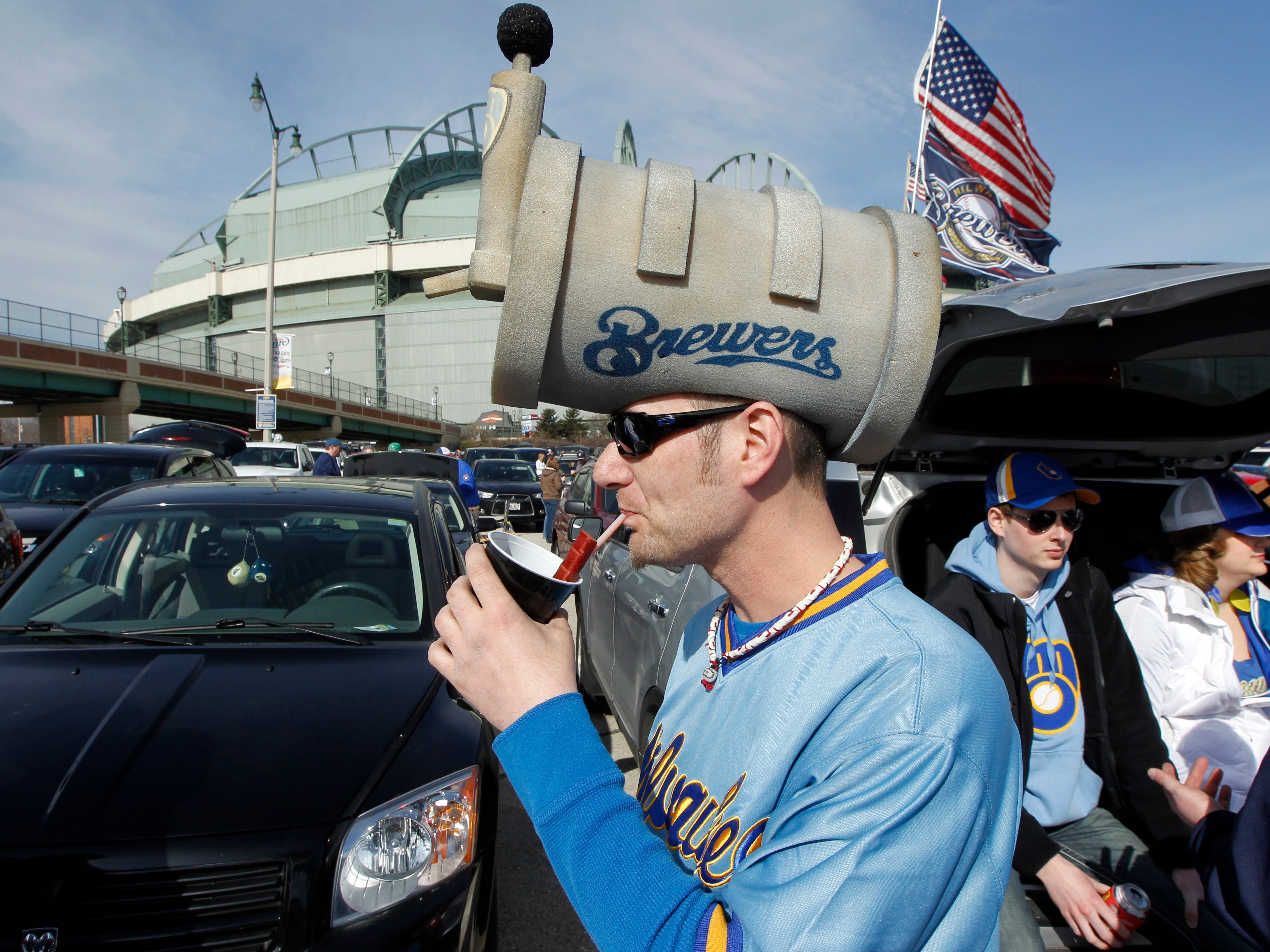 Ron Pokos Jr. enjoys a Bloody Mary (maybe the keg on his head is the chaser) before the Milwaukee Brewers' home opener against the Atlanta Braves on March 31, 2014, at Miller Park. The Brewers won, 2-0.