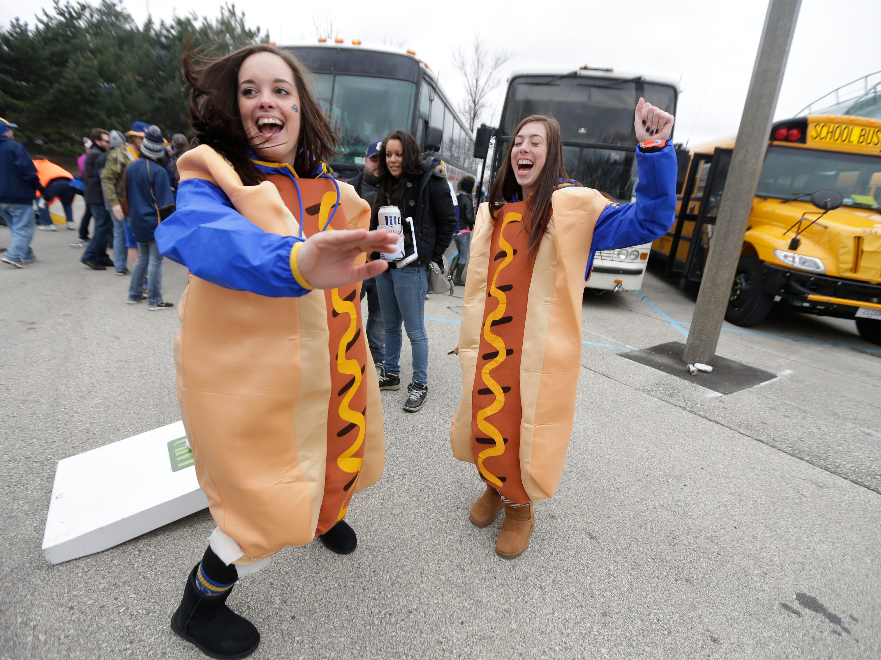 Brittany Hannes (left) and her sister Brooke Hannes get their hot dogs on before the Milwaukee Brewers faced the San Francisco Giants for the home opener at Miller Park on April 4, 2016. The Brewers lost, 12-3.