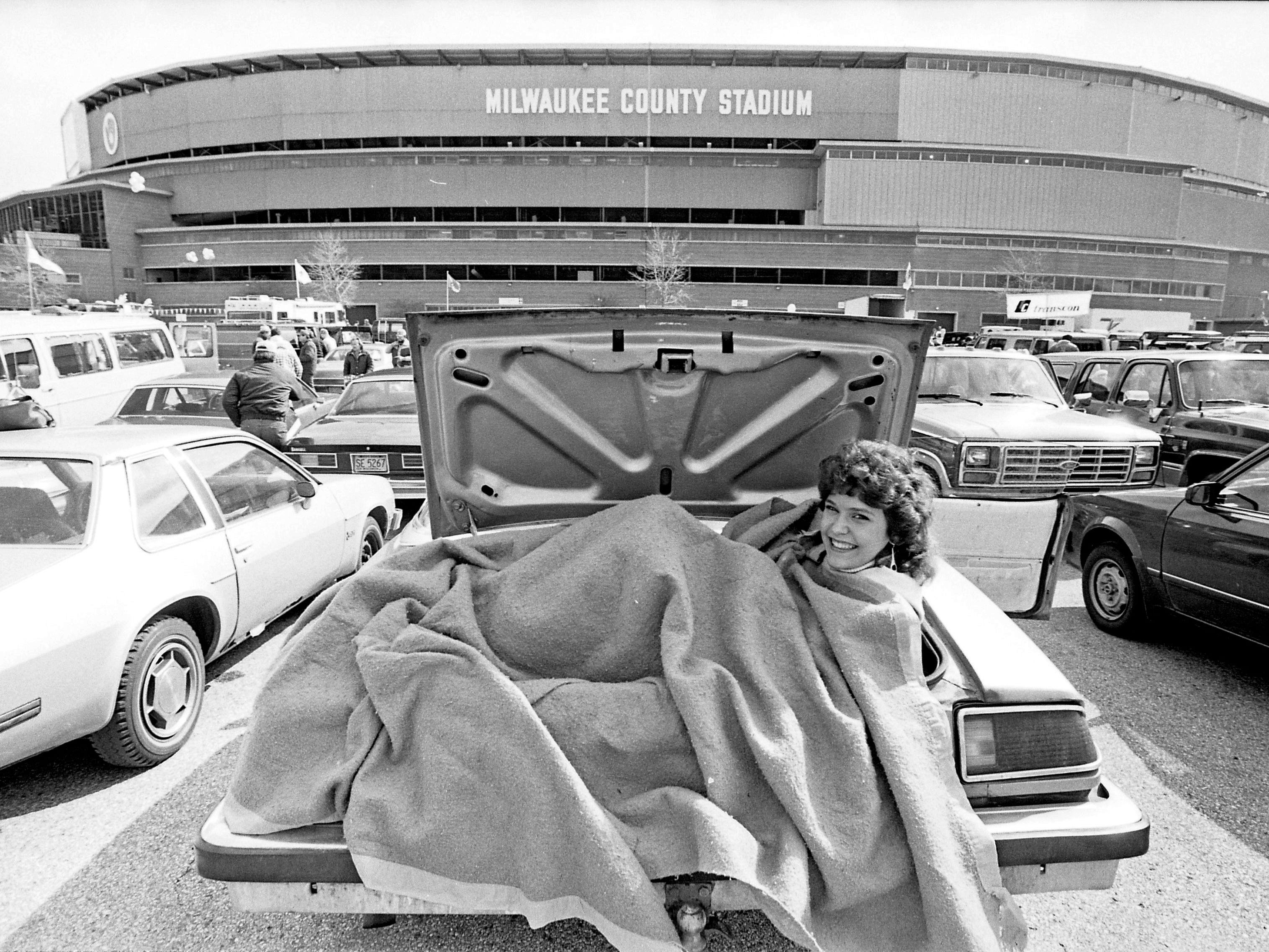 Sandy Kathelser finds an unusual place to warm up as she waits for County Stadium to open on April 9, 1985, for the Milwaukee Brewers' home opener. It was 41 degrees as 53,207 fans turned out to see the Brewers lose to the Chicago White Sox, 4-2, on opening day.