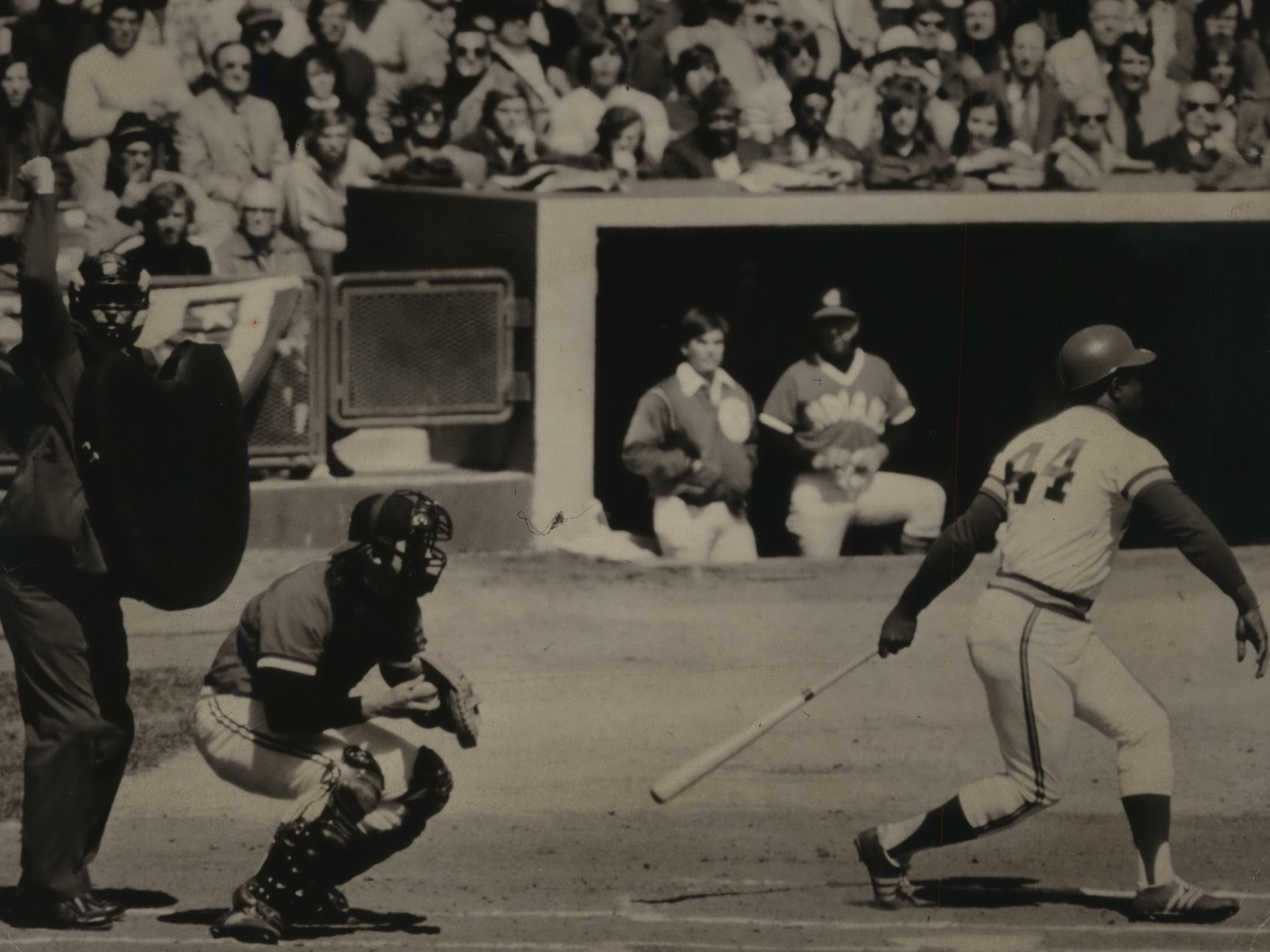 The eyes of Milwaukee and Wisconsin are on Hank Aaron as the home run king returned to the stadium in a Milwaukee uniform for the first time since 1965 for the Brewers' home opener on April 11, 1975. Aaron missed this pitch in his first time at-bat, but ended up with a walk. He singled later in the game, a 6-2 victory over the Cleveland Indians. This photo was published on the front page of the April 12, 1975, Milwaukee Sentinel.