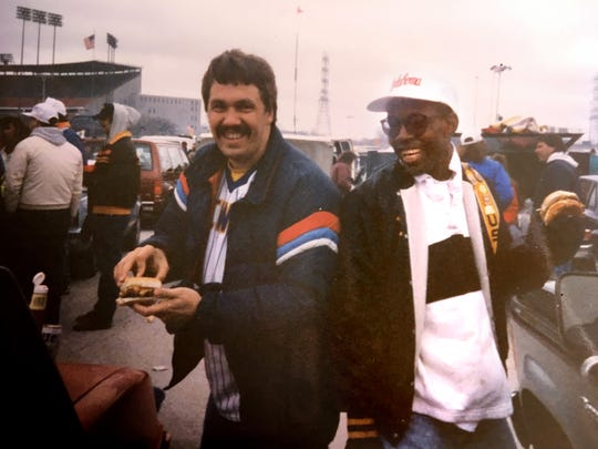 About 30 years ago, Jay Saeger (left) enjoys the home opener with a buddy from work, James Livingston, with Milwaukee County Stadium in the background.