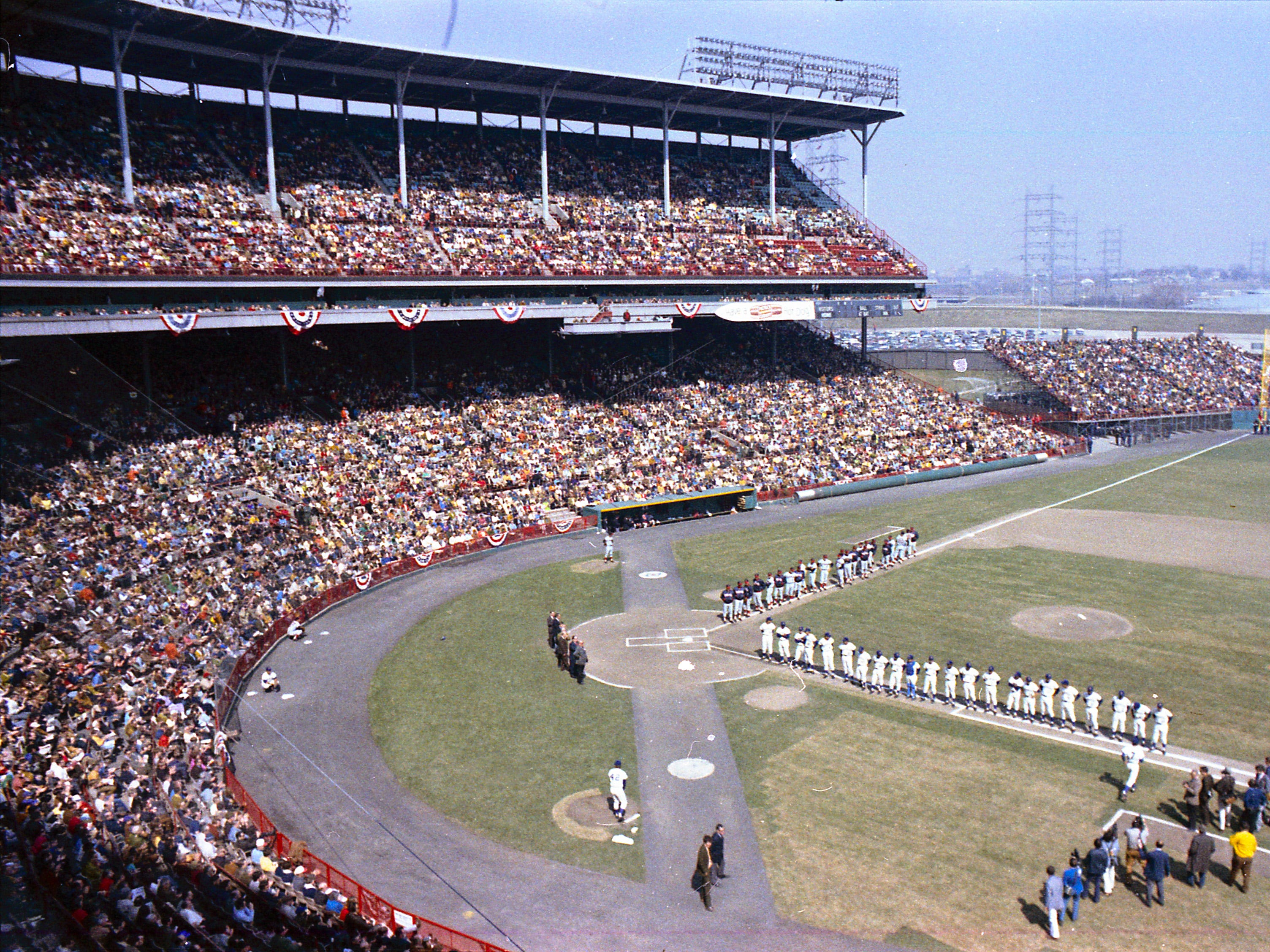 The Milwaukee Brewers and California Angels take part in opening-day ceremonies at a packed County Stadium on April 10, 1971. The Brewers won the home opener, 4-3. This photo was published in the April 11, 1971, Milwaukee Journal.