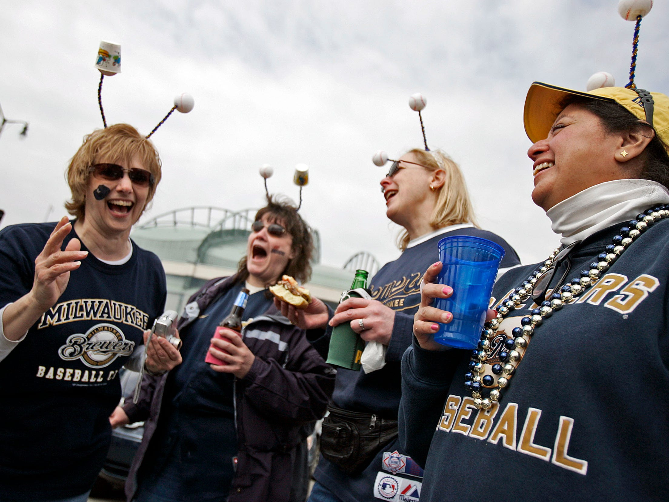 Jodi Garrett (from left), Janet May, Diane Oakes and Michelle Golvan enjoy their 18th opening day together at a tailgate party outside Miller Park Friday on April 4, 2008. In the home opener, the Milwaukee Brewers beat the San Francisco Giants, 13-4.