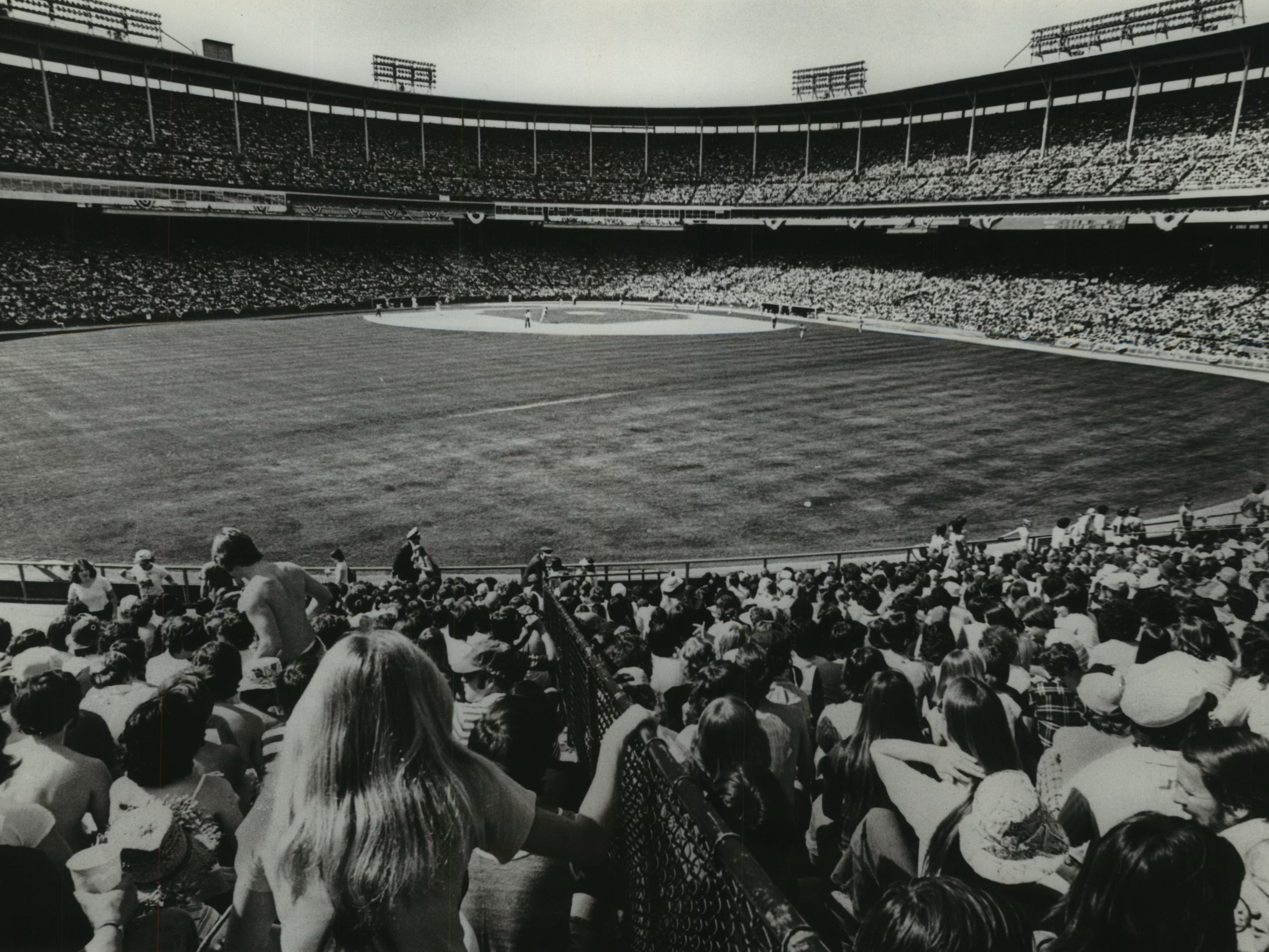 The Milwaukee Brewers' biggest crowd of the season, 55,120, watch the team lose the home opener to the Baltimore Orioles, 1-0, on April 12, 1977. This photo was published in the Dec. 20, 1979, Milwaukee Journal.