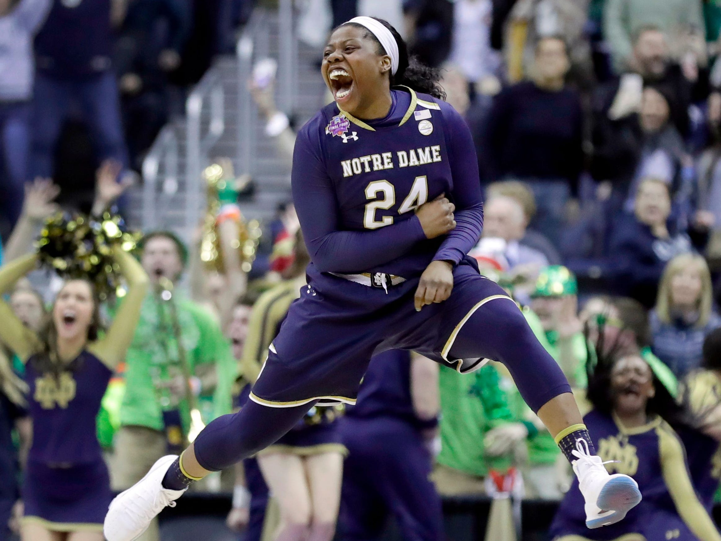 Notre Dame's Arike Ogunbowale, a 2015 Divine Savior Holy Angels graduate, celebrates after making a game-winning shot in overtime over Connecticut, 91,89, on March 30, 2018, to send the Irish to the national championship game. Two days later, Ogunbowale hit another game-winning shot - this time a 3-pointer against Mississippi State - that gave Notre Dame its second national title.