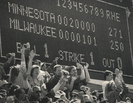 Fans in the bleachers cheer on the Milwaukee Brewers after they tie the Minnesota Twins at the home opener day of the 1992 season at County Stadium on April 6, 1992.