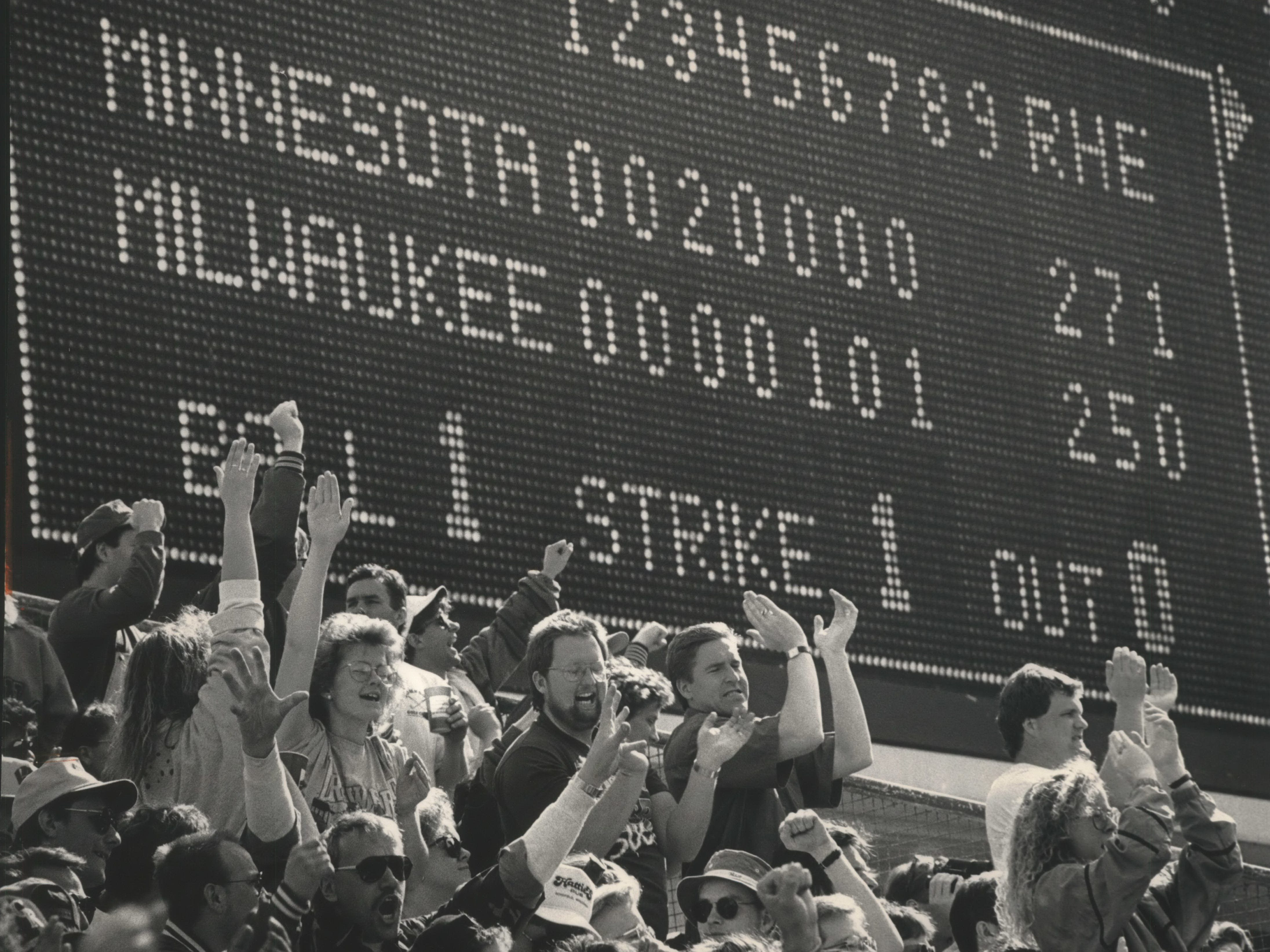 Fans in the bleachers cheer on the Milwaukee Brewers after they tie the Minnesota Twins at the home opener day of the 1992 season at County Stadium on April 6, 1992. Unfortunately, the Twins came back to win, 4-2. This photo was published in the April 7, 1992, Milwaukee Journal.