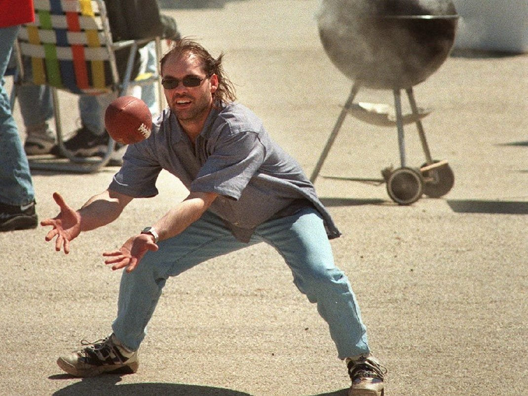 Luke Hoepner of Allenton tosses a football with friends while tailgating in the north parking lot before opening day at County Stadium on April 7, 1998. In the opener, the Milwaukee Brewers' first home game in the National League at County Stadium, the Brewers defeated the Montreal Expos, 6-4.