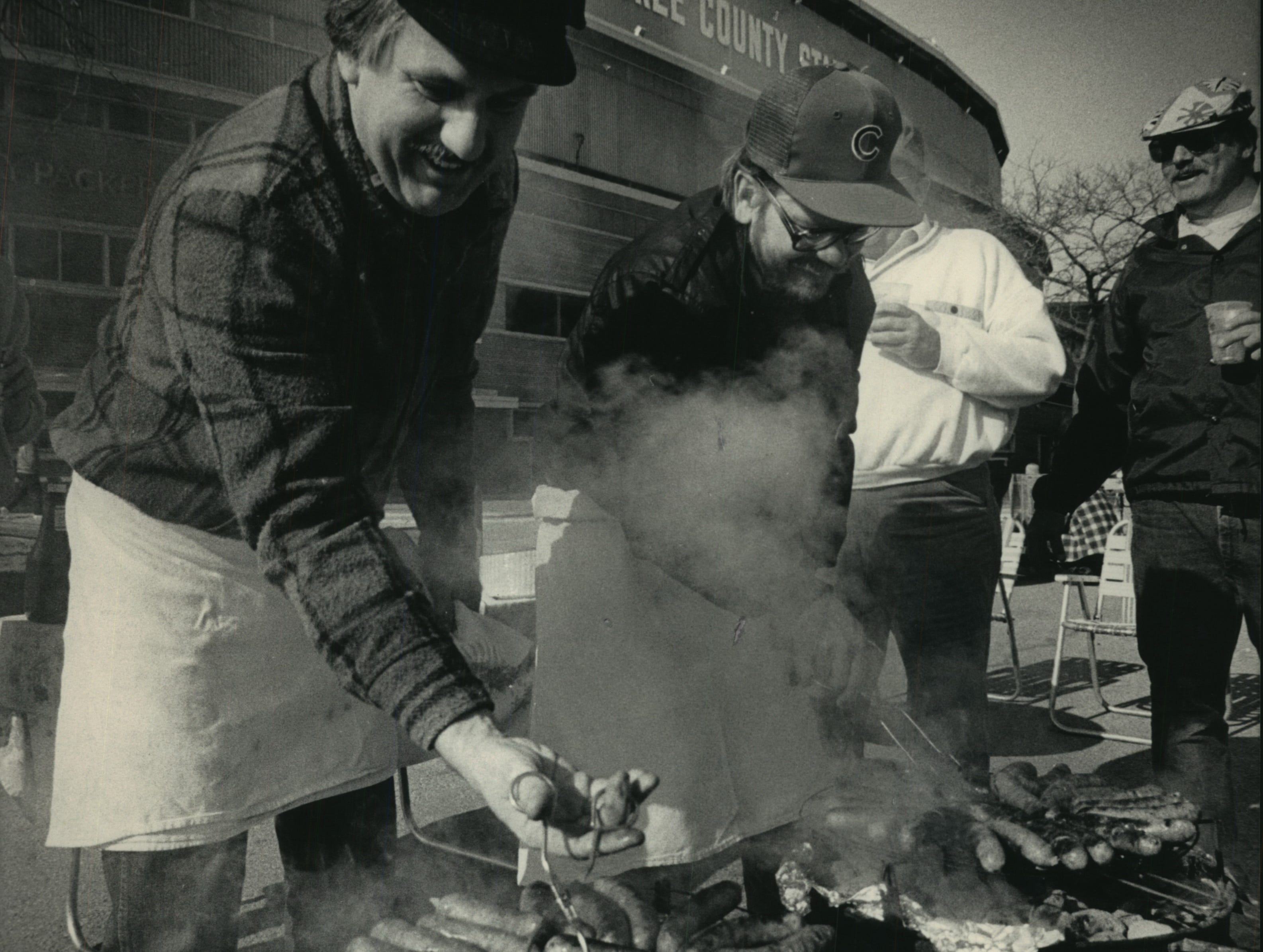 John Graber (left) and Bill Hammerie do the cooking as they joined friends under sunny skies in the parking lot at County Stadium for opening day on April 6, 1987. The Brewers' 5-1 win over the Boston Red Sox in the home opener started a 13-game winning streak, tying a major-league record to start off a season (the record still stands). This photo was published in the April 6, 1987, Milwaukee Journal.