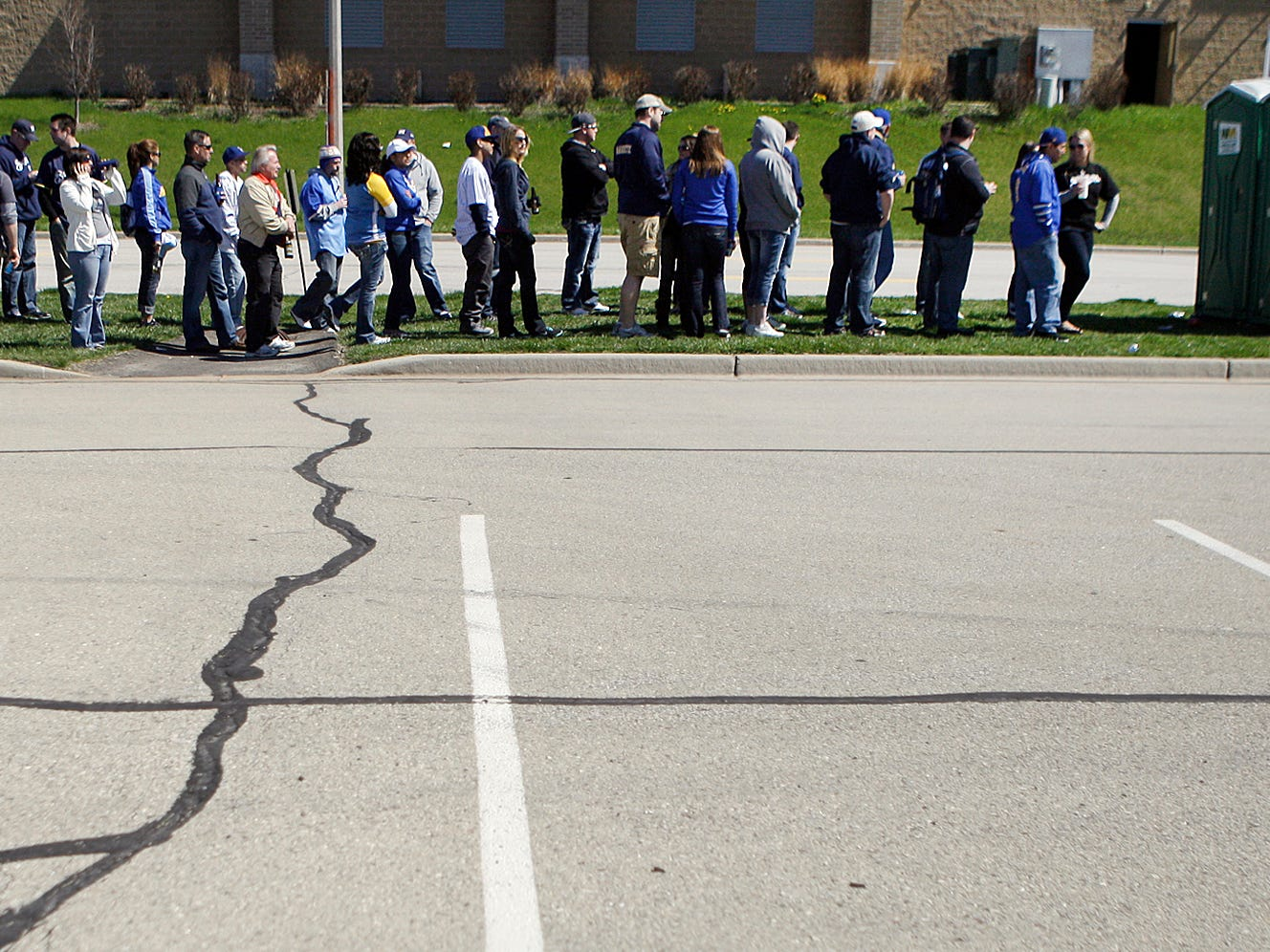 The bathroom lines grow very long for the two Porta-Potties at the back of the parking lot on opening day of the 2012 Milwaukee Brewers season, April 6, 2012. In the game inside Miller Park, the Brewers lost to the St. Louis Cardinals, 11-5.